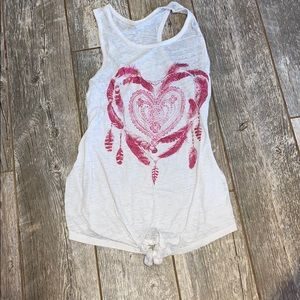 Small white tank top with design on front